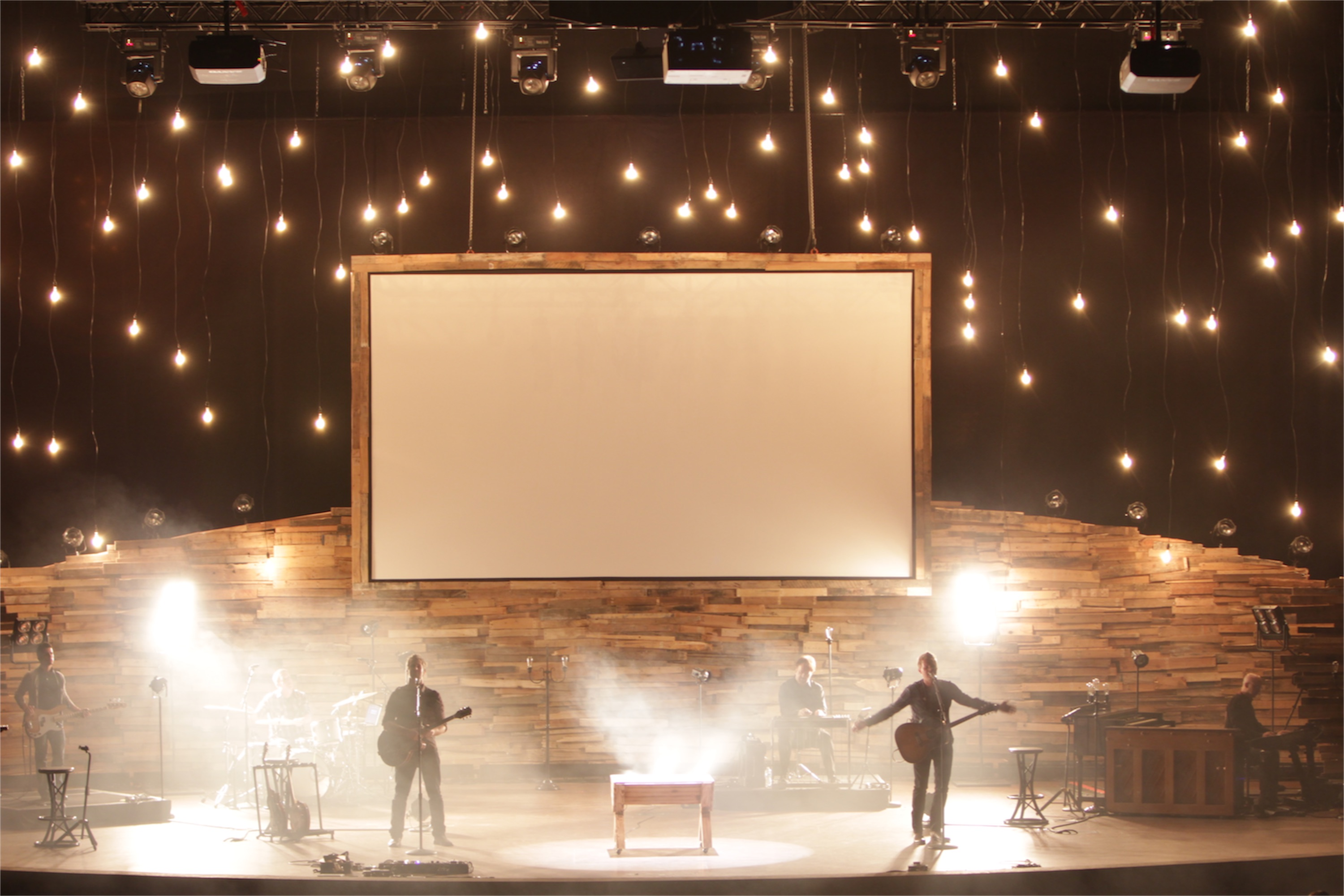 repurposed wood pallets for church worship stage wall lighting reclaimed walls and screens louisville decorative outdoor adds mystique